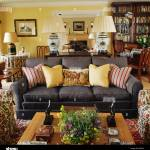 Pale Yellow And Striped Cushions On Dark Grey Sofa In Yellow