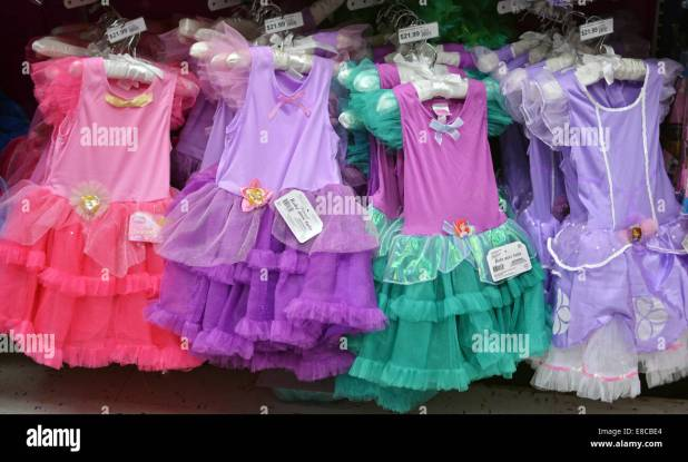 display of halloween costumes for young girls at the party city