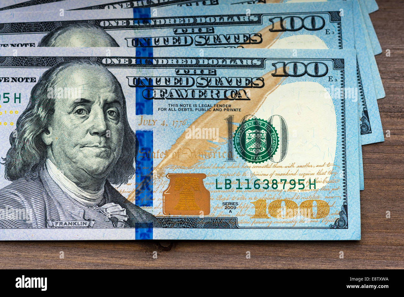 New Hundred Dollar Bills On Wooden Background Stock Photo