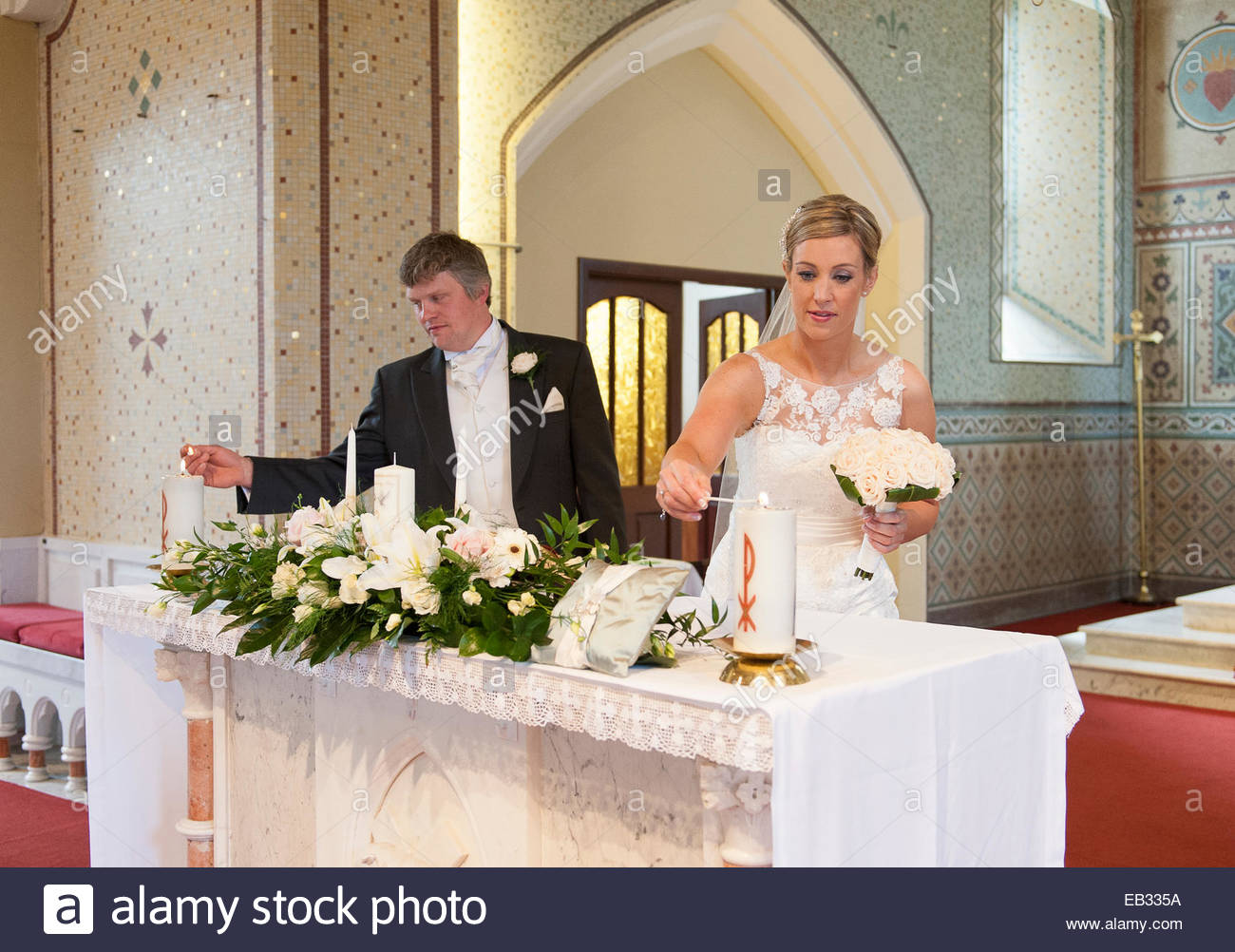 https www alamy com stock photo a bride and groom light their wedding candles during their wedding 75671046 html
