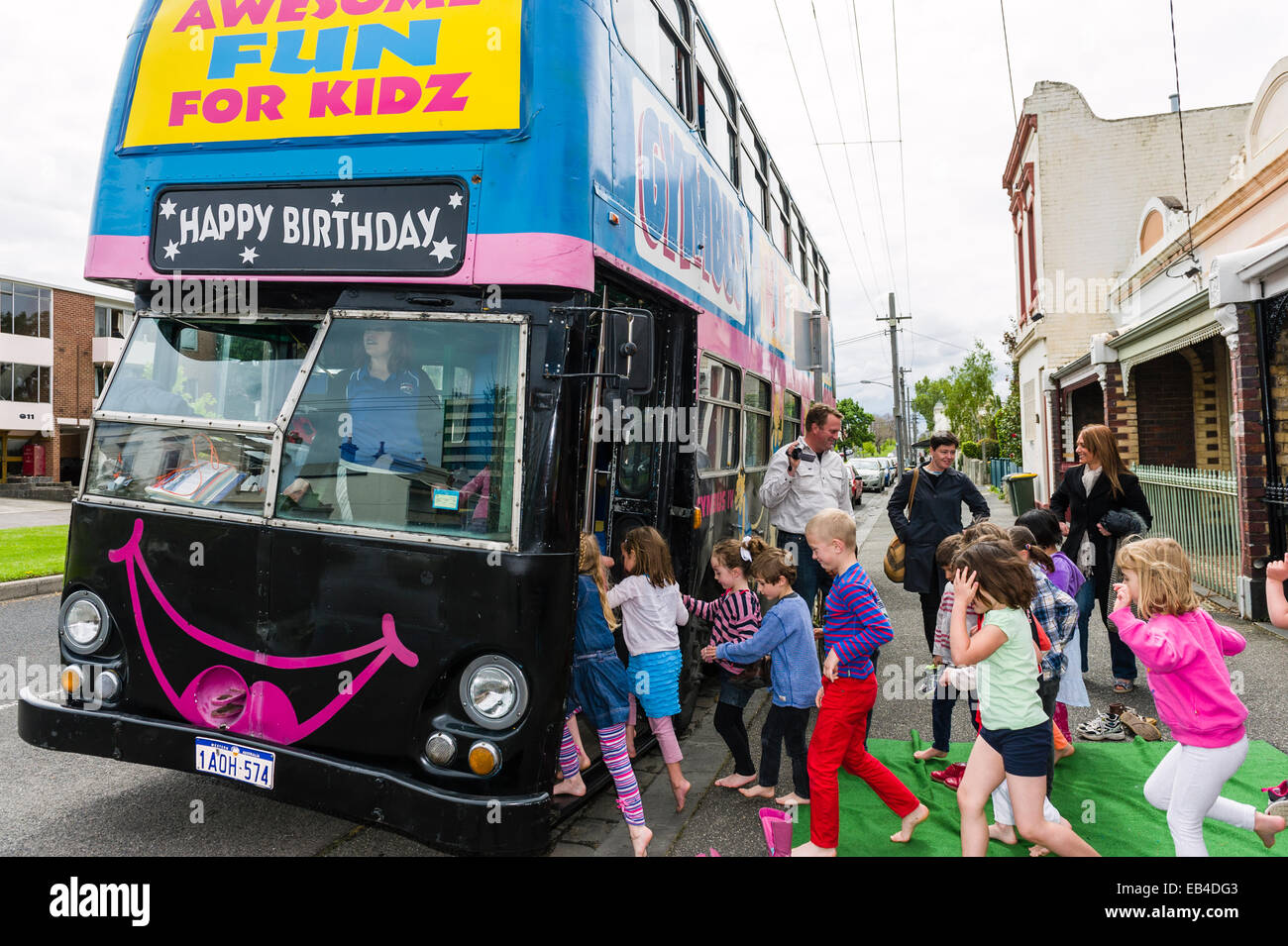 Children Rush Onto A Double Decker Bus Converted Into A Birthday Party Venue For Gymnastic Activities Stock Photo Alamy