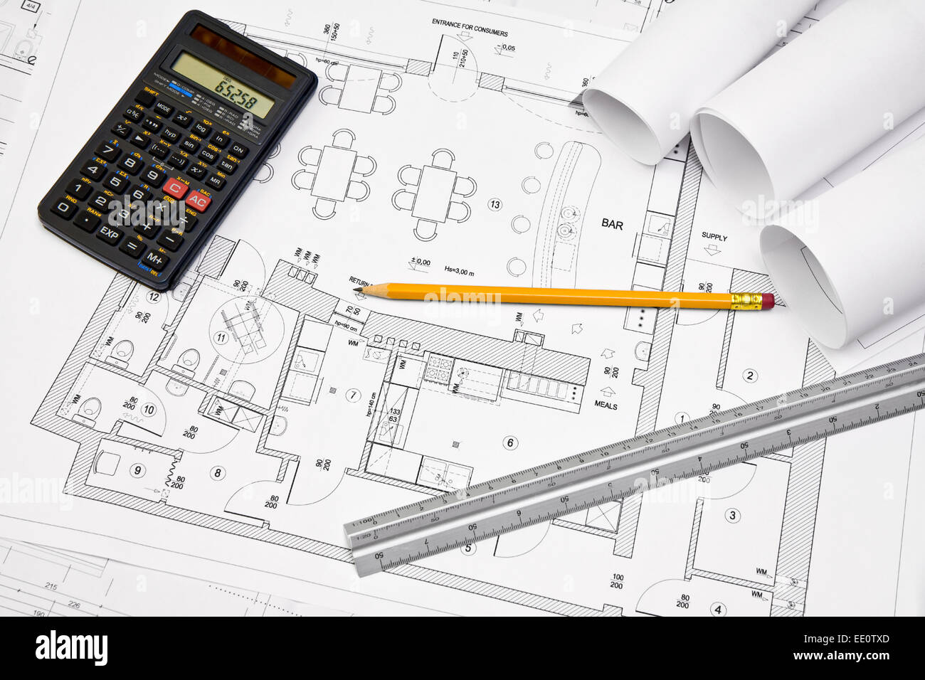 Calculator, Scale Ruler And Pencil On Architectural