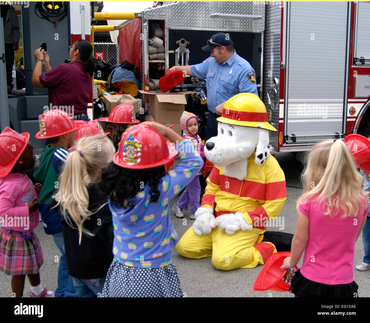 Sparky The Fire Dog Plays With Children During A Fire