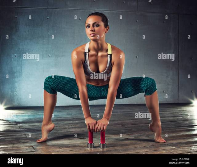 Young Sports Sexy Fitness Woman With Dumbbells Stretching