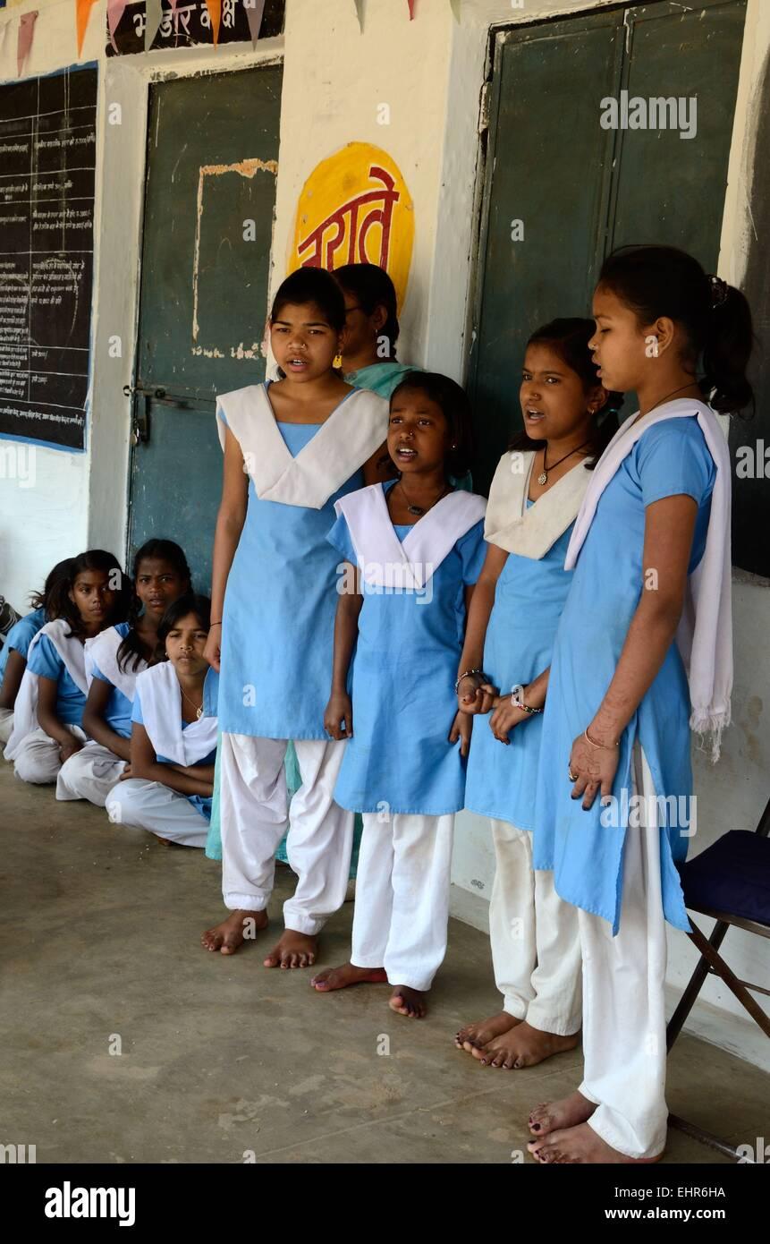A group of Indian school girls wearing school uniform in a ...