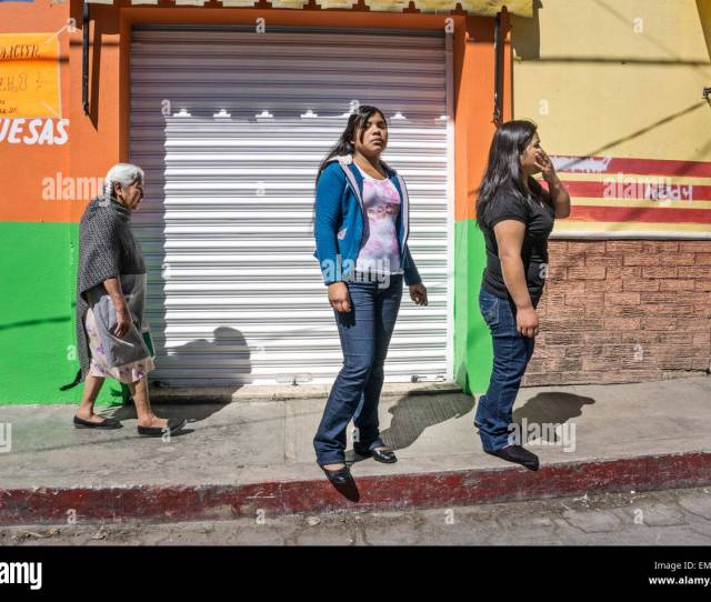 Dignified Old Indigenous Mexican Indian Woman Is A Contrast With  Indian Teens Wearing Tight Jeans