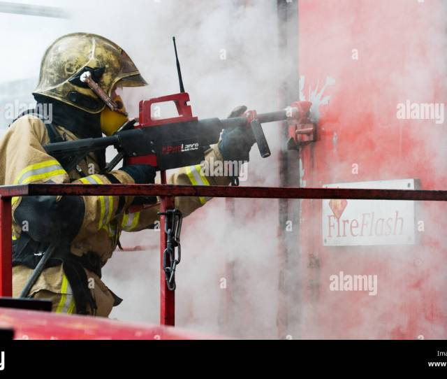 A Fire Fighter Uses A So Called Pyrolance To Extinguish A Fire In A Burning Container At The Trade Show For Rescue Disaster Relief And Fire Prevention