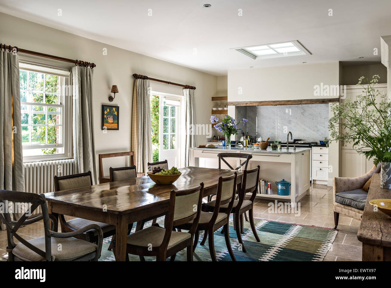 Antique Dining Table With Chairs In Open Plan Kitchen