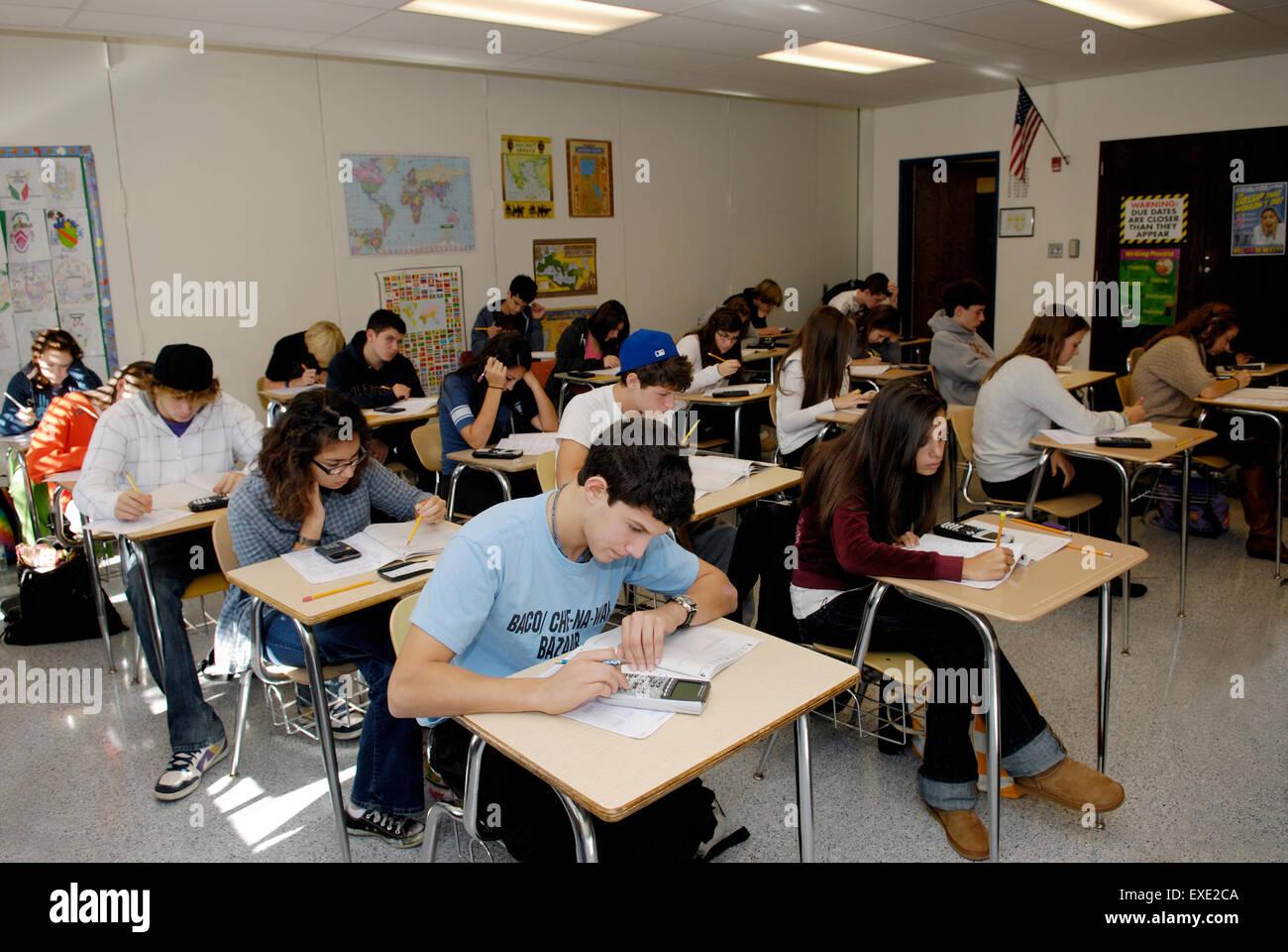 Students In High School Classroom Taking A Standardized