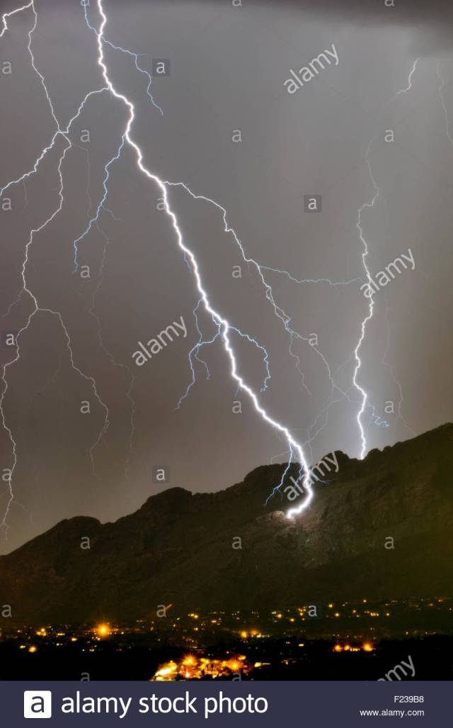 A Huge Lightning Bolt Strikes The Side Of The Santa Catalina Mountains Near Pusch Ridge At