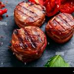 Grilled Meat Fillet Steak Wrapped In Bacon Medallions Stock Photo Alamy