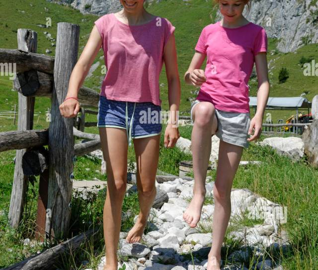 Germany Bavaria Lenggriestwo Girls Walking Barefoot On Stone Path At Mountain Pasture At Brauneck Mountain