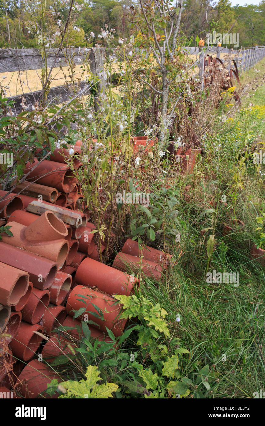 https www alamy com stock photo old clay drainage tiles against a fence 91279526 html