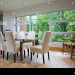 Glass Dining Table And Leather Chairs In Front Of Large Window In Stock Photo Alamy