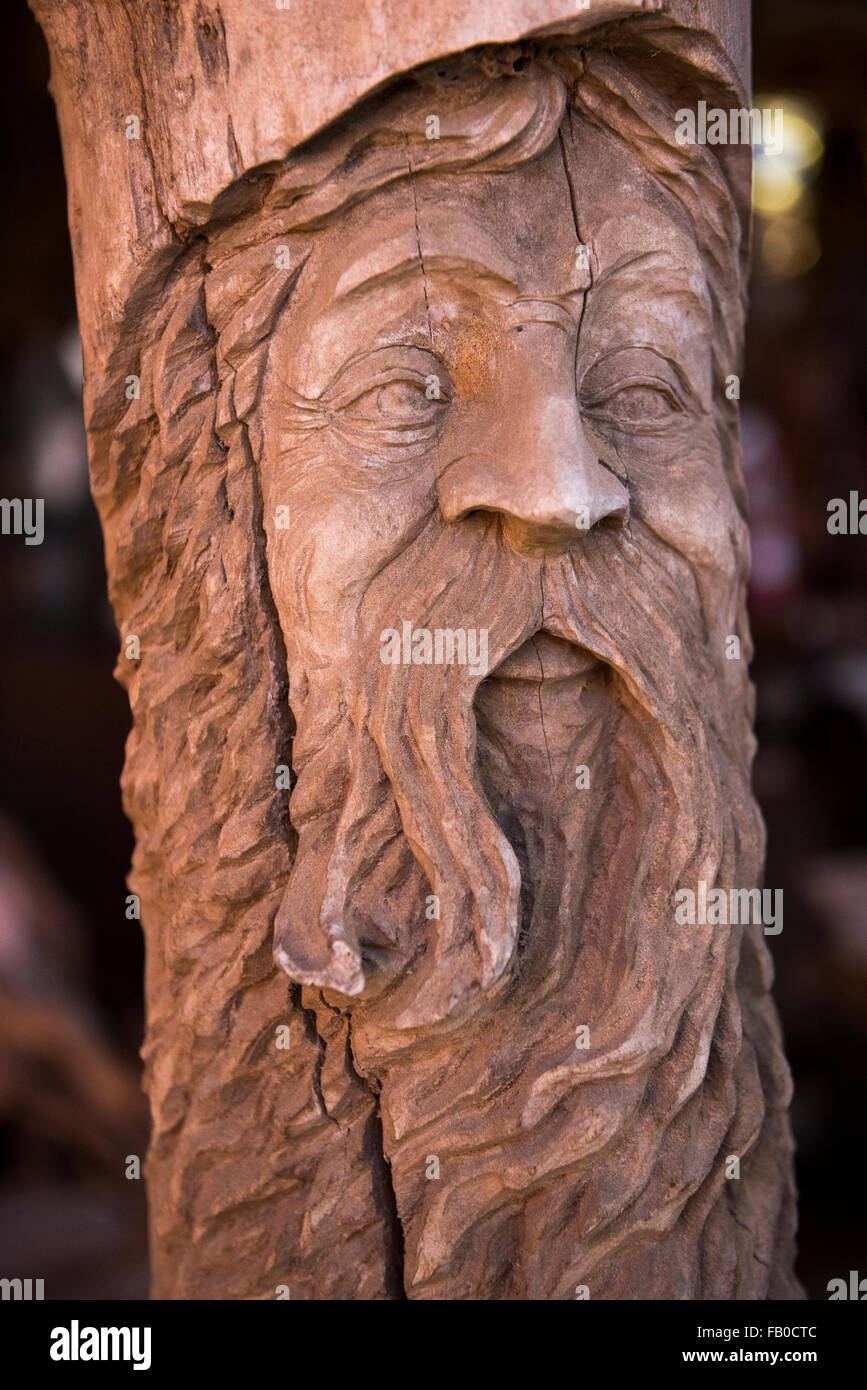 A Wooden Carving Of An Old Mans Face In A Pole At Its A
