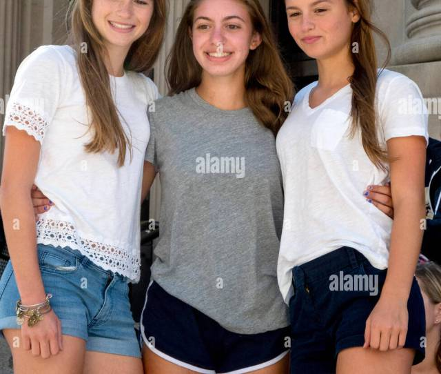 Three Smiling Teen Girls Pose For A Photo Outside New Yorks Metropolitan Museum Of Art On Fifth Avenue