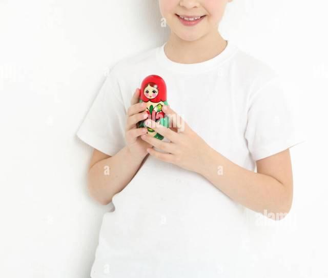 Cheerful European Teen Girl Holding Matryoshka Stock Image
