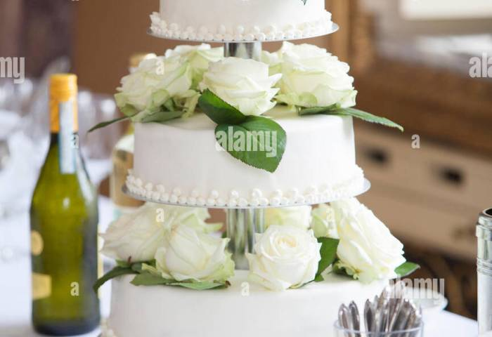 White Wedding Cake With White Roses Stock Photo 95452544 Alamy