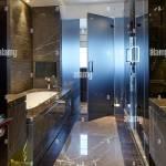 Interior Dark Marble Bathroom With Glass Door Tudor Hall Potters Stock Photo Alamy