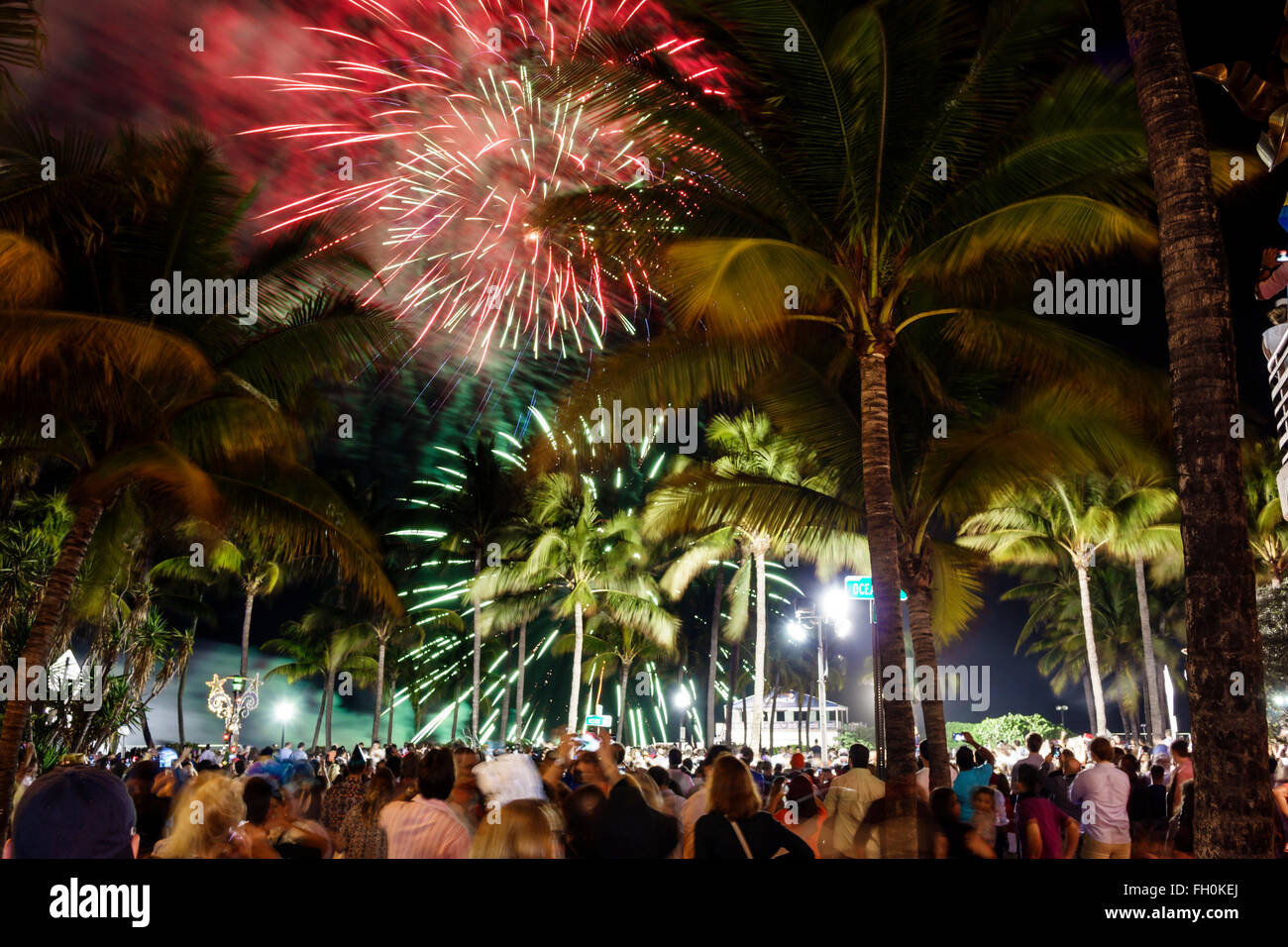 Miami Beach Florida Ocean Drive New Year s Eve celebration fireworks     Miami Beach Florida Ocean Drive New Year s Eve celebration fireworks crowd  display palm trees