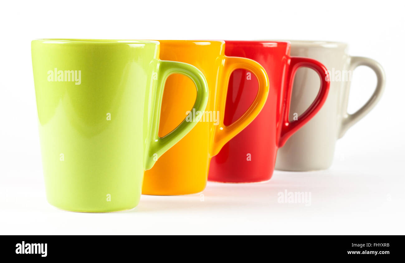 Four Color Tea Cups Shown In Row White Background Stock