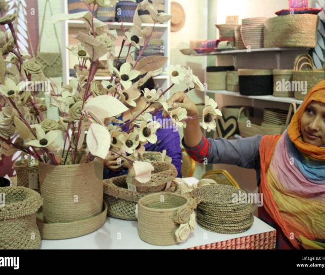 A Visitor Touches A Jute Product At A Stall During A Three Day Fair At Bangabandhu International Conference Center In Dhaka Bangladesh On March 6 2016