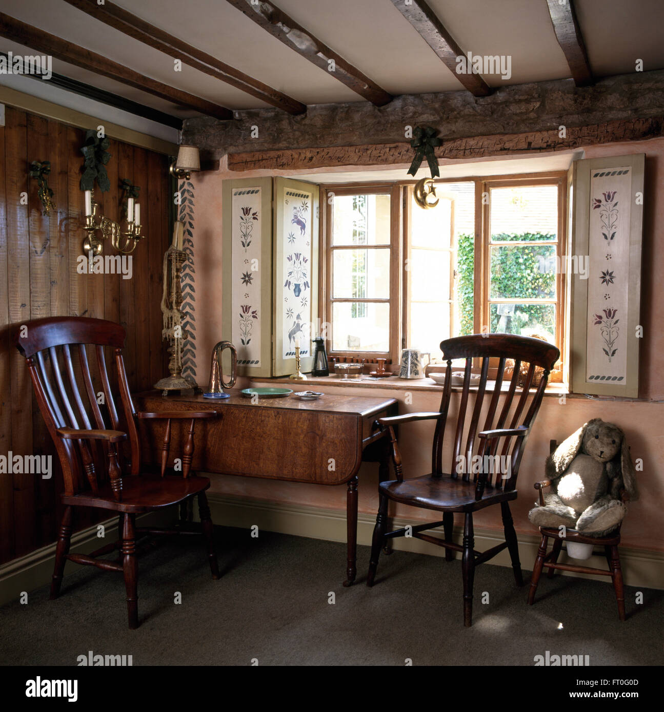 Antique Windsor Chairs And Old Table Below Window With