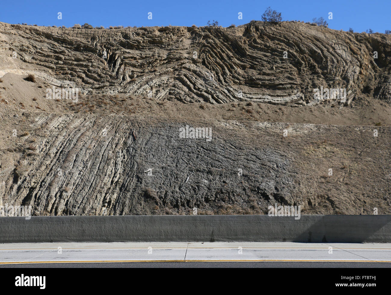 Deformed Rock Layers In Road Cut Along San Andres Fault