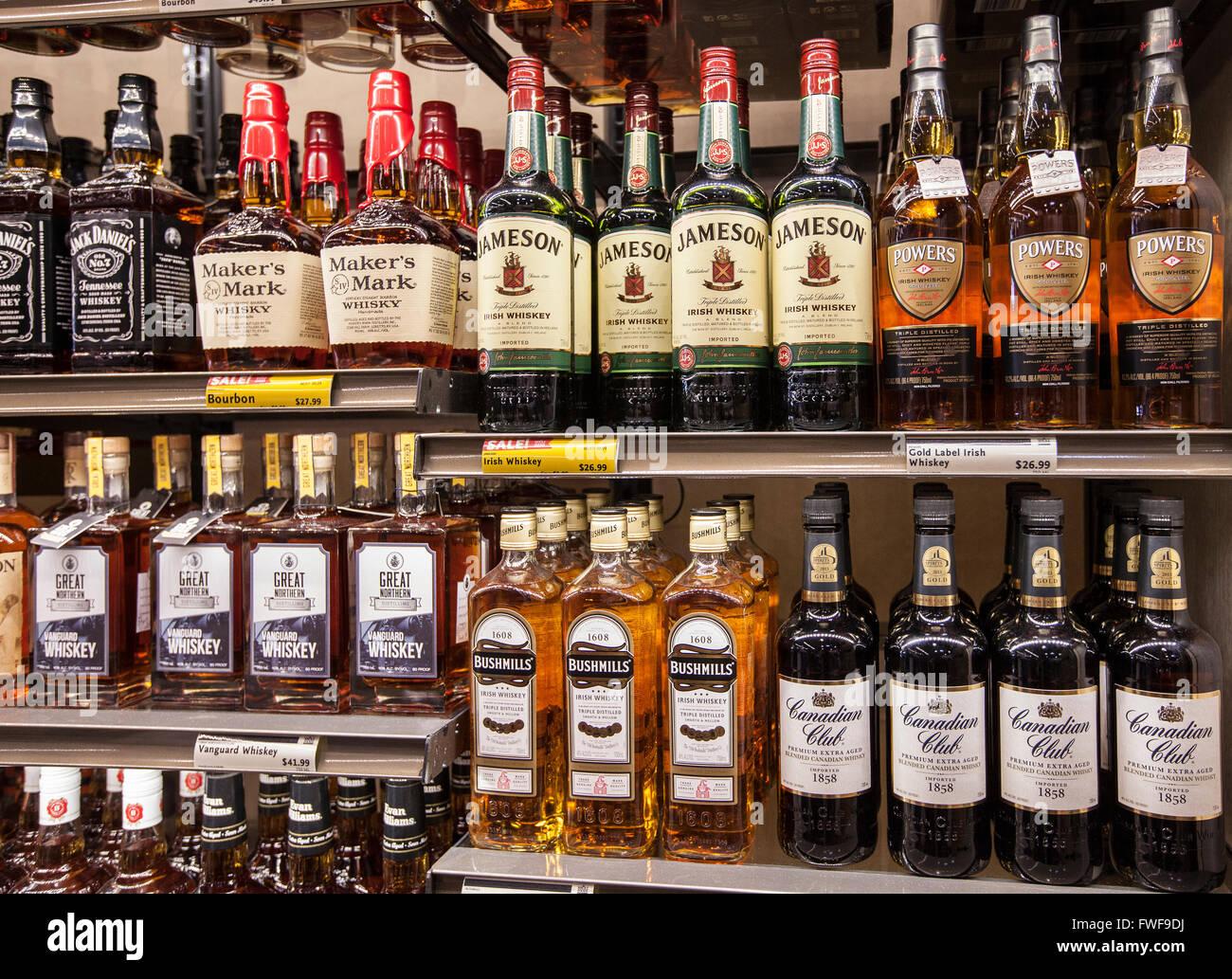 Bottles Of Alcohol On The Shelves Of A Liquor Store Stock