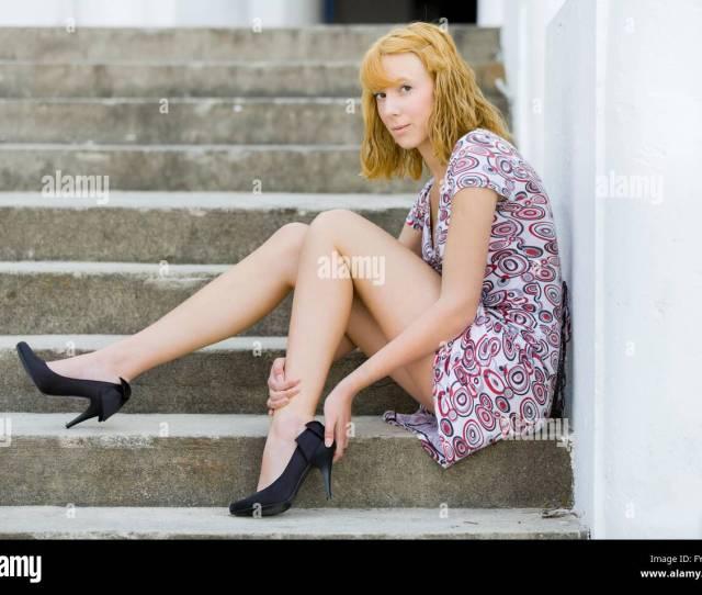Slender Teen Girl Sitting On Staircase Holding Leg Shoe With Hands Mini Short Dress Mini Dress Minidress Stilettos Stiletto Fatigue Fatigued