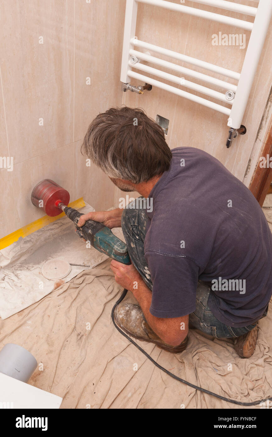 https www alamy com stock photo a builder drilling a hole through ceramic tiles for a 4 inch soil 103117519 html