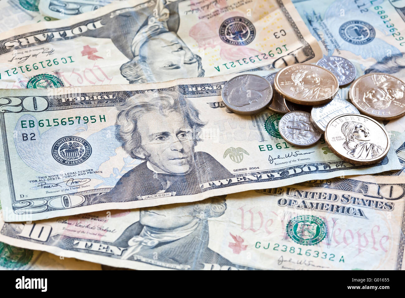 Us Currency Closeup Of Bills And Coins Stock Photo