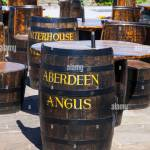 Patio Recycled Whiskey Or Whisky Barrels Used As Tables And