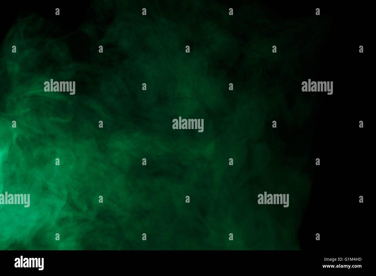 abstract art. green smoke hookah on a black background. inhalation