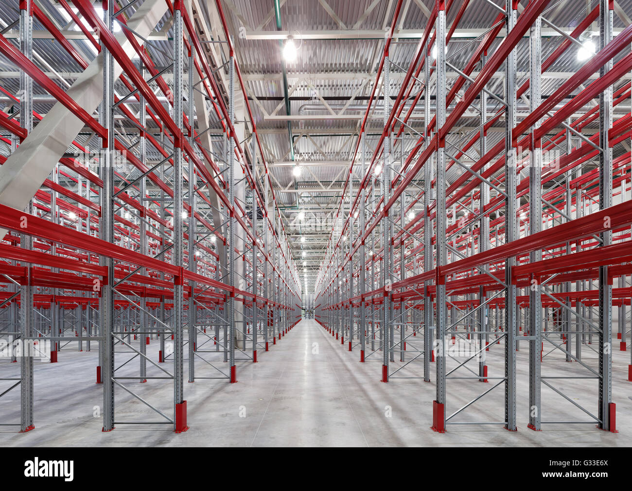 Industrial Racks Pallets Shelves In Huge Empty Warehouse