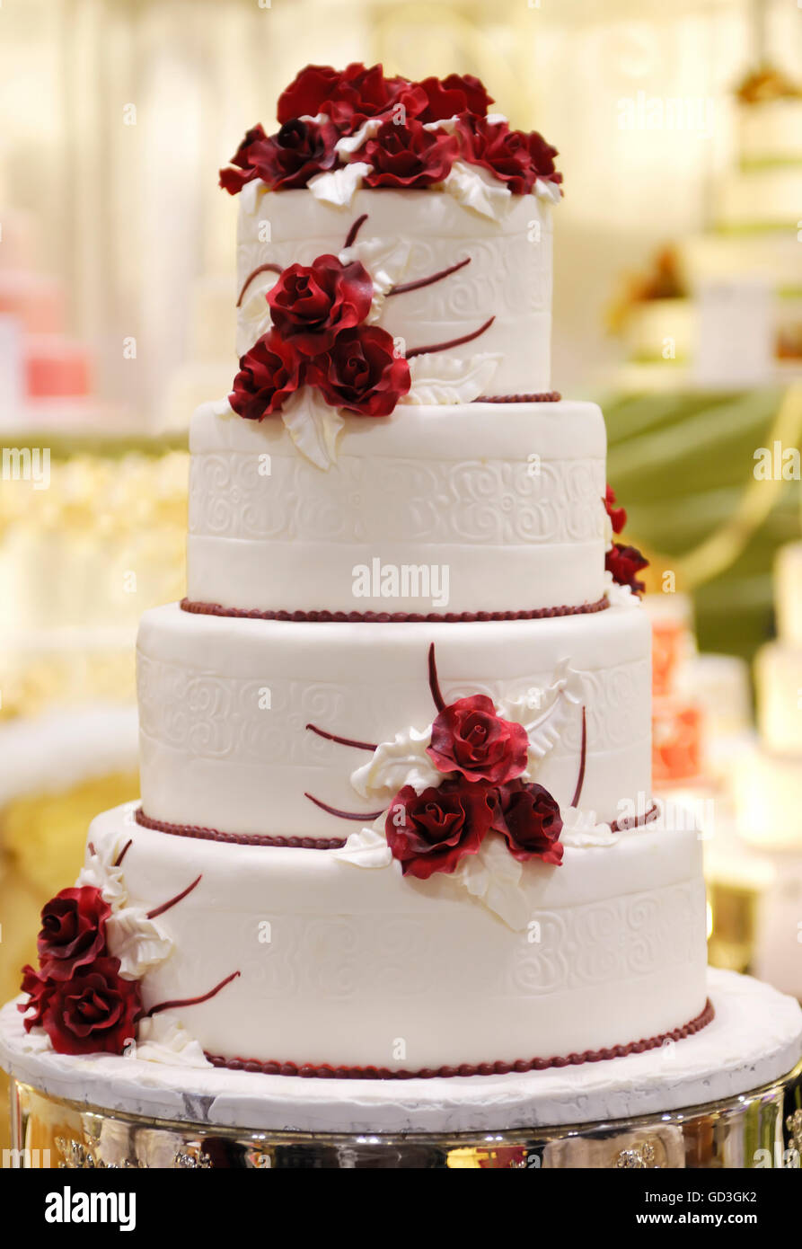 Wedding Cake Decorated Red Roses Stock Photos   Wedding Cake     Tiered wedding cake decorated with red roses   Stock Image