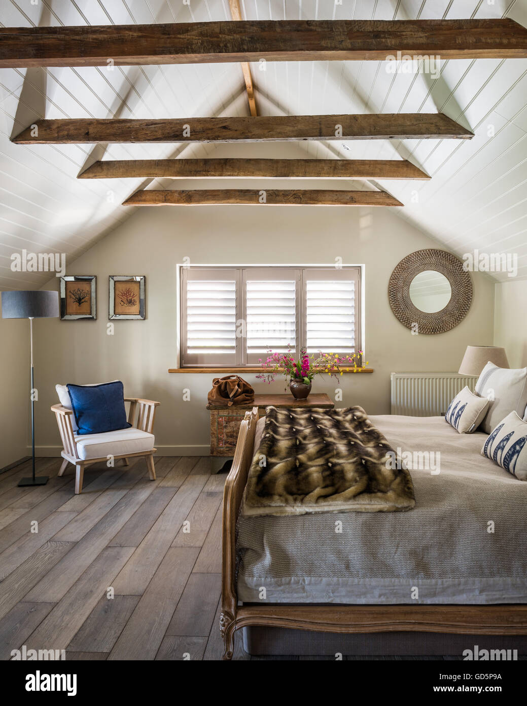 Plantation Shutters And White Wooden Ceiling Cladding In