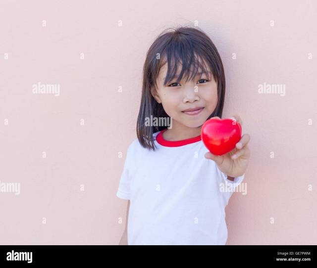 Little Asian Girl Show Big Red Heart Concept Lover And Careful