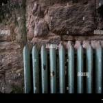 A Green Radiator Against A Stone Wall Stock Photo Alamy
