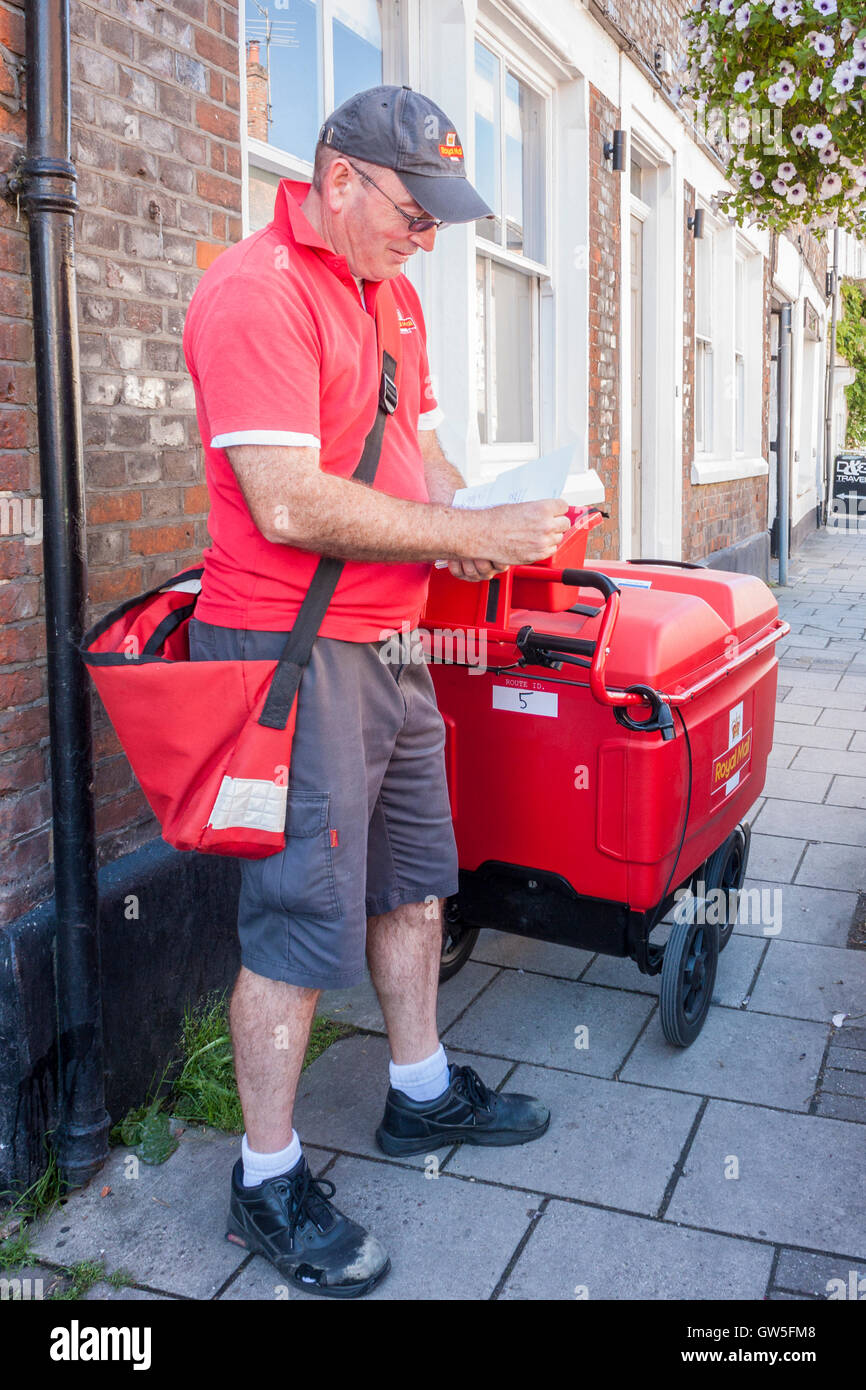 Royal Mail Postman On Delivery Round England GB UK