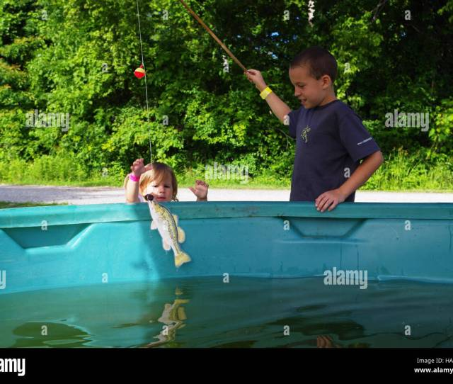Eddiesfisheriesfws 18232250680 Brother Catches A Fish For His Sister From The Toddler Tank At 2014 Kids Fishing Derby On Crab Orchard Nwr Illinois