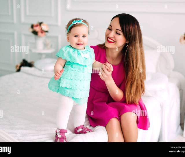 Mother And Baby Closeup Portrait Happy Faces European Family Picture Adorable Small Girl