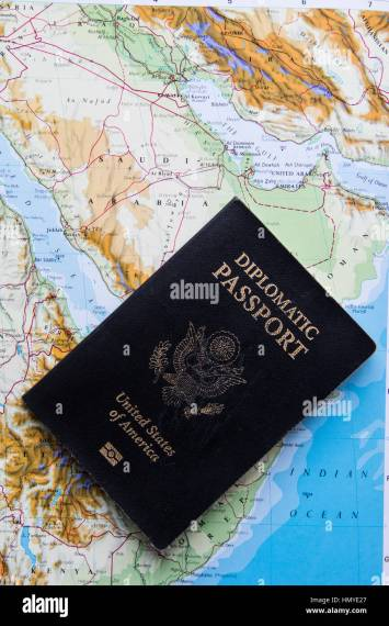 Diplomatic passport of the United States of America on a map of     Diplomatic passport of the United States of America on a map of Saudi Arabia