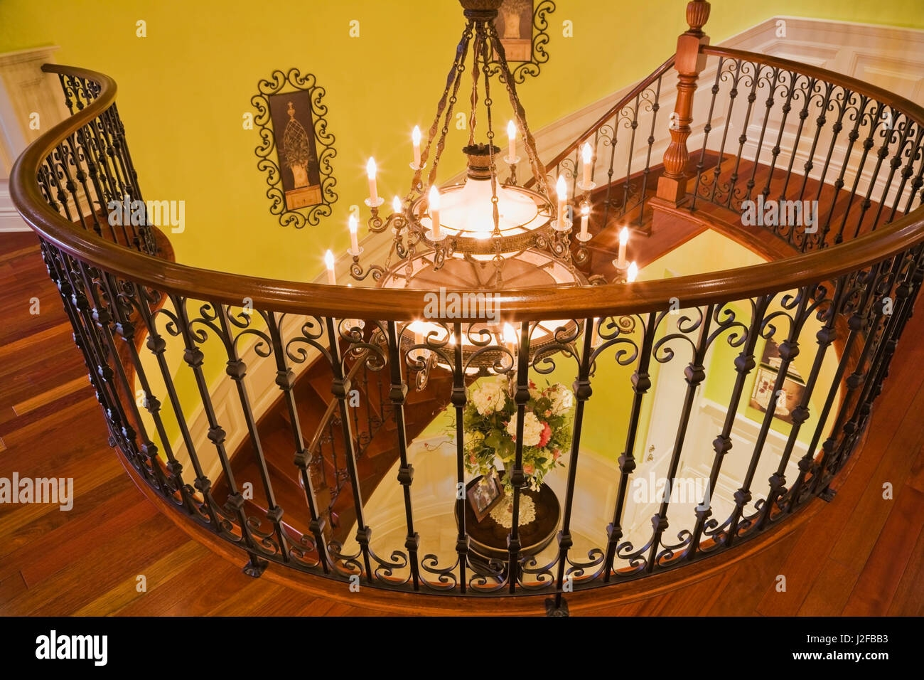 Illuminated Chandelier Through Black Wrought Iron Railing And | Iron Railing With Wood Handrail | Stair Systems | Stair Parts | Metal | Stair | Staircase