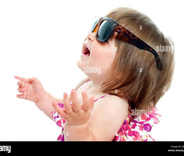 Baby Girl Wearing Over Sized Sunglasses Looking Up And Enjoying Herself Stock Image