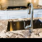 New Modern Faucet And Kitchen Sink Closeup With Island And Granite Stock Photo Alamy