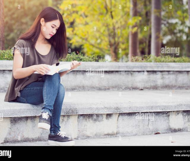 Asian Teen Women Reading Book Happiness And Smile Enjoy Education In University