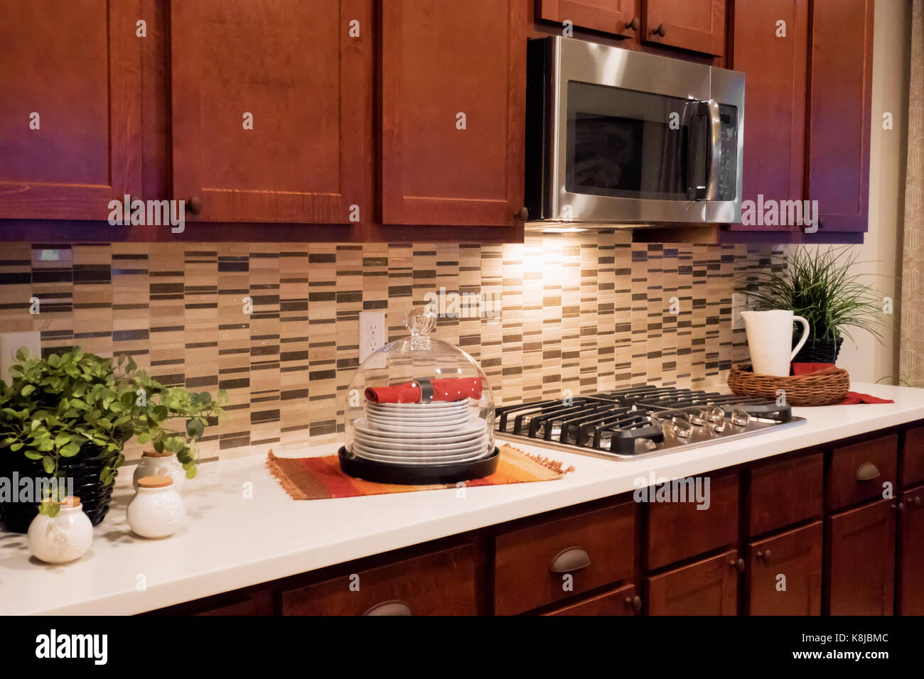 https www alamy com stock image a kitchen countertop with a stove top microwave with a beautiful backsplash 160214892 html