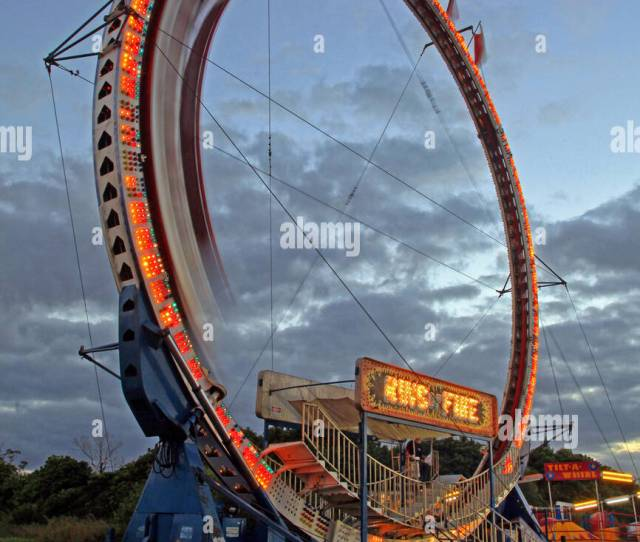 Ring Of Fire Amusement Park Ride In Motion At Dusk