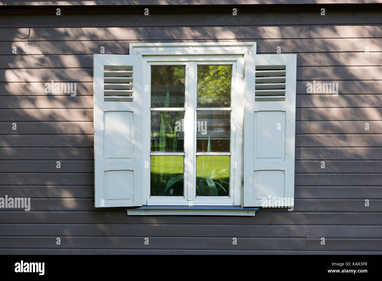Small Vintage White Window With Shutters On Wooden Grey Wall